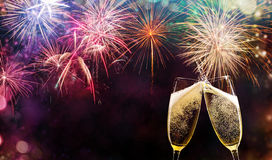 Two glasses of champagne over fireworks background. Celebration concept, free space for text Royalty Free Stock Photography