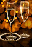 Two glasses of champagne with pearl necklace Royalty Free Stock Images