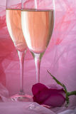 Two Glasses of Champagne and a Pink Rose Royalty Free Stock Photo