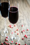 Two glasses of champagne with pomegranate seeds Stock Images