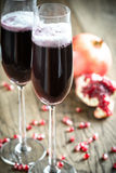 Two glasses of champagne with pomegranate seeds Stock Photo