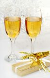 Two glasses of champagne with present and horn Royalty Free Stock Photography