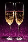 Two glasses of champagne ready for christmas celebration Stock Images