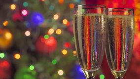 Two glasses of champagne ready for christmas stock video footage