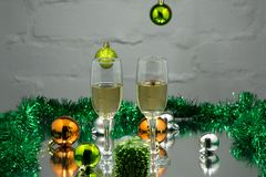Two glasses of champagne ready for christmas celebration, on red background Stock Image