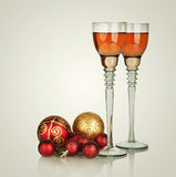 Two glasses of champagne with red Christmas ball Royalty Free Stock Photography