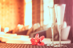 Two glasses of champagne with red flower in a spa lounge. Spa ti Stock Images