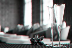 Two glasses of champagne with red flower in a spa lounge. Spa time concept. Spa lounge area. Glitch effect. Two glasses of champagne with red flower in a spa stock image