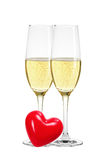 Two glasses of champagne and red heart isolated Royalty Free Stock Images