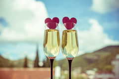 Two glasses of champagne. And red hearts Stock Image