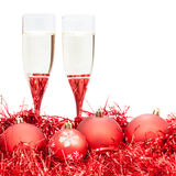 Two glasses of champagne at red Xmas decorations Stock Image