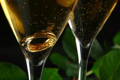 Two glasses of champagne with the ring inside Stock Photo