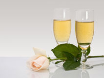 Two glasses  with by champagne and rose Stock Photos