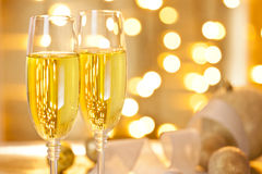 Two Glasses of Champagne Set on a Christmas Table Stock Photo