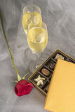 Two Glasses of Champagne, Single Red Rose and an Open Box of Gourmet Chocolates #3 Royalty Free Stock Images