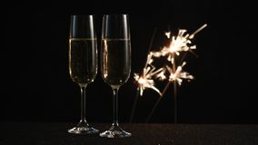 Two glasses with champagne and sparkles stock footage