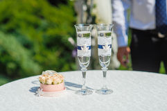 Two glasses with champagne and stand for rings Stock Image