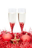 Two glasses of champagne and star at red tinsel Stock Photo
