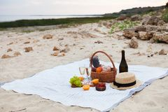 Two glasses of champagne. Picnic on the beach at sunset in the w stock images