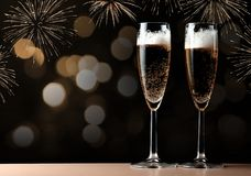 Two glasses with champagne on a table. Royalty Free Stock Image