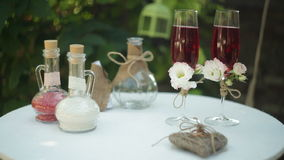 Two glasses with champagne on the table for the wedding ceremony stock video footage