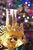 Two glasses of champagne and venetian mask Royalty Free Stock Images