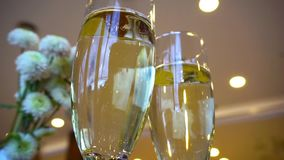 Two glasses of champagne waiting to be served by guests stock footage