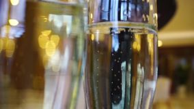 Two glasses of champagne waiting to be served by guests. In a restaurant stock footage