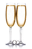 Champagne and wedding rings Royalty Free Stock Images