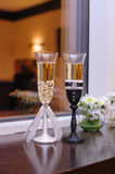 Two glasses with champagne wedding style bride and groom Stock Photo