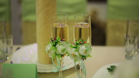 Two glasses of champagne at the wedding table stock video footage