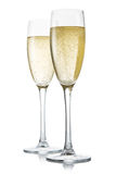 Two glasses of champagne on a white Royalty Free Stock Photography