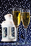 Two glasses of champagne and a white lantern Stock Photo