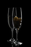 Two glasses of champagne or wine with grape Royalty Free Stock Photos