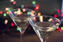 Two glasses of champaign. Close up. Two glasses of champaign on a dark bokeh background. Close up Royalty Free Stock Photo
