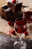 Two glasses with cherry liqueur stock images