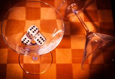 Two glasses on a chessboard royalty free stock photo