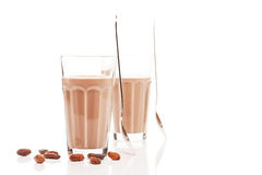 Two glasses with chocolate milk and chocolate beans Royalty Free Stock Photos