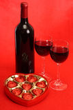 Two glasses and chocolates Stock Images