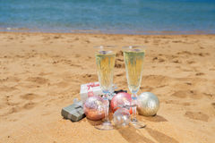 Two glasses of christmas champagne Stock Images