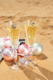 Two glasses of christmas champagne Stock Photos