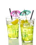 Two glasses with cocktail and ice with lime slice on white background Stock Photo