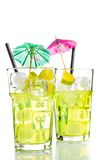 Two glasses with cocktail and ice with lime slice on white background Royalty Free Stock Image