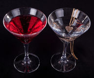 Two glasses of cocktails. And jewelry on a black background Stock Images