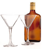 Two glasses for cocktails. And empty brown bottle Stock Photo