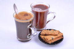 Two glasses with coffee and cocoa Stock Photos