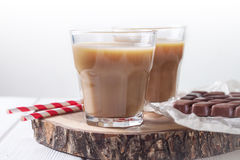 Two glasses of coffee and straws Stock Images