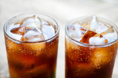Two glasses of cola with ice. Close-up of a refreshing drink.  Royalty Free Stock Photos