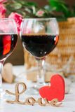 Two glasses of cola on Valentine's day celebration.  royalty free stock photos