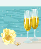 Two glasses of cold champagne, flower and ring Stock Photos